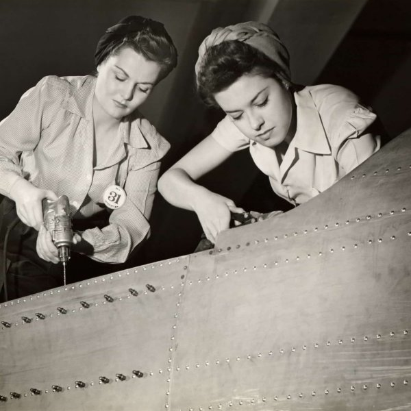 Two women working on a WW2 fighter plane in the 1940's